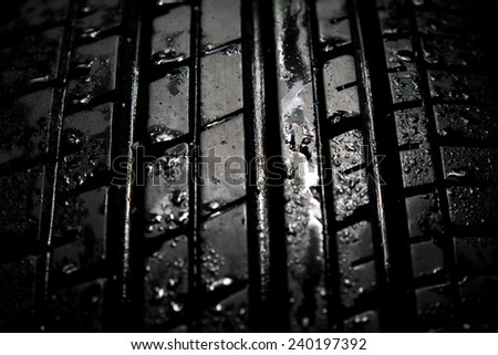 Car tires close-up on black background - stock photo