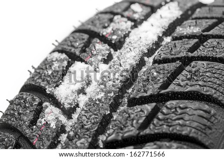 Car tires close-up Winter wheel profile structure with snow on white background - stock photo
