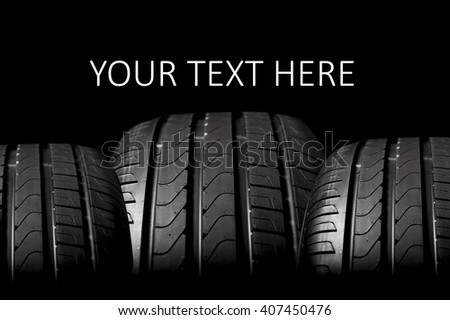 Car tires isolated on black background with copy space - stock photo