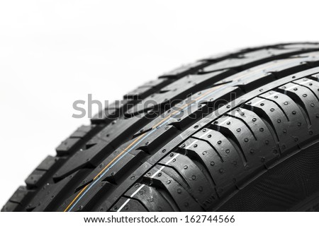 Car tires profile close-up wheel structure on white background - stock photo