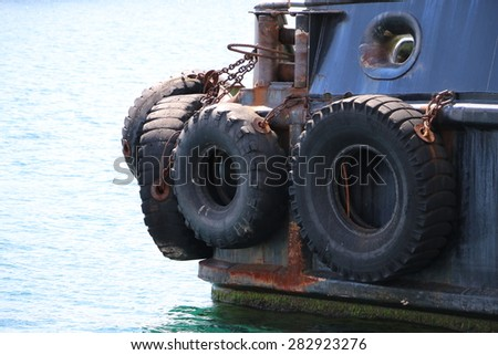 car tires used as a fender for a ship