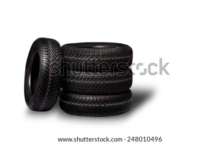 Car tires. Winter wheel profile structure on white background - stock photo