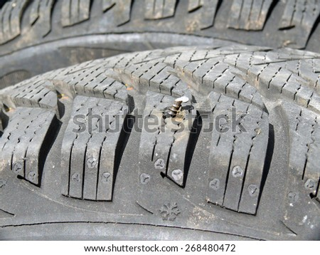 car tires with metal pieces - stock photo