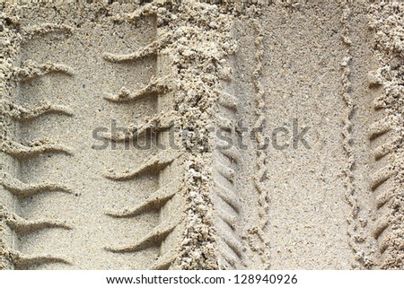 Car tracks in the sand - stock photo