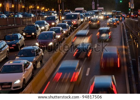 Car traffic at night captured on film with an increased exposure. Background. - stock photo