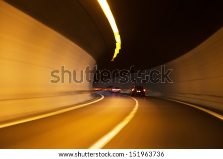 car traffic with motion blur in a tunnel - stock photo