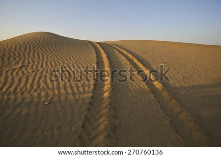 Car trail desert - stock photo