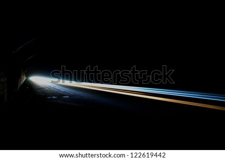 Car trails in tunnel .Long exposure photo. - stock photo
