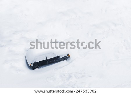 Car Trapped in Deep Snow Build-up after a Blizzard or Big Snow Storm - stock photo