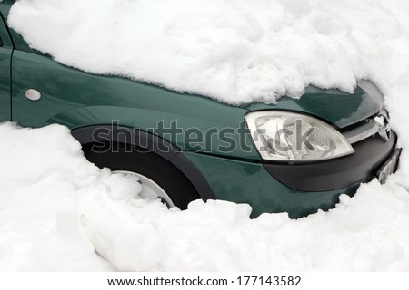 Car trapped under snow after heavy snow storm - stock photo