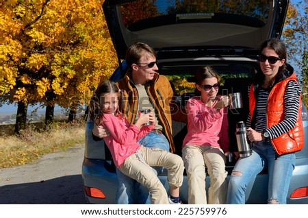 Car trip on autumn family vacation, happy parents and kids travel and have fun, car insurance concept  - stock photo