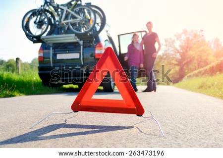 Car Trouble on a Holiday Trip - family is happy about arriving road assistance - stock photo