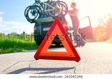 Car Trouble - Woman is checking the roof box - stock photo