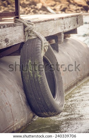 Car tyre tied for protect bumping on boat