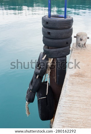 Car tyre tied for protect bumping on boat,mak island,thailand - stock photo