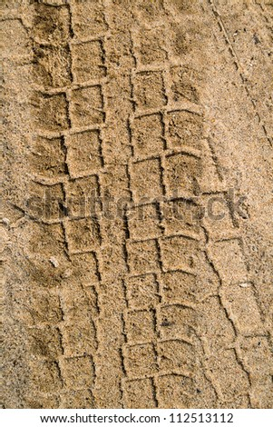 Car tyre tracks in the sand. Beach background. - stock photo