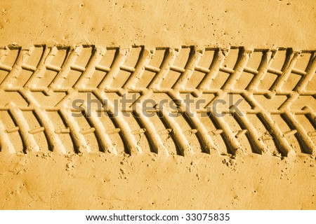 Car tyre tracks in the sand. Beach 4wd background.