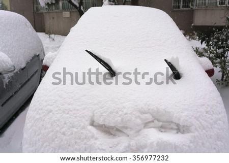 Car under snow in winter. - stock photo