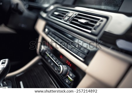 car ventilation system and air conditioning - details and controls of modern car. Concept wallpaper with minimalist industrial design - stock photo