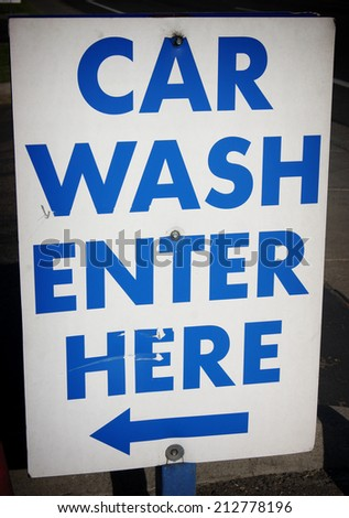 car wash enter here sign with arrow