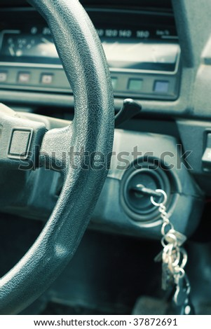 Car wheel and dashboard. Focus on wheel - stock photo