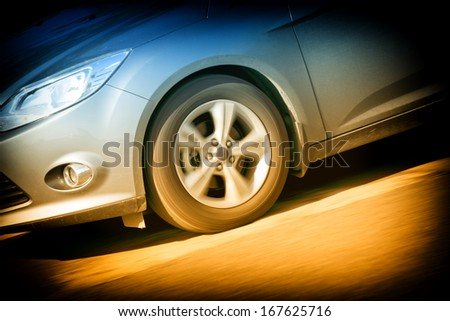 car wheel faster on the road - stock photo