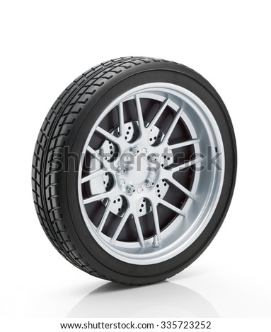 Car wheel isolated on white background with a soft reflection. Clipping path - stock photo