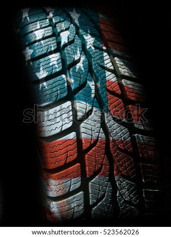 Car wheel on a background United States flag