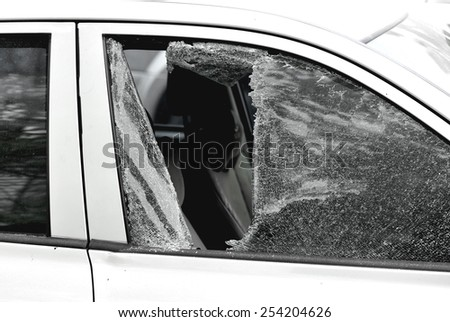 car window smashed by a thief - stock photo