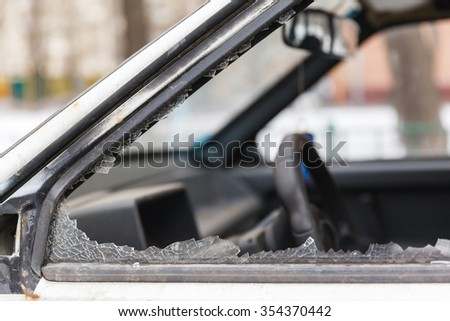 car window smashed by a thief, the slums of Russia - stock photo