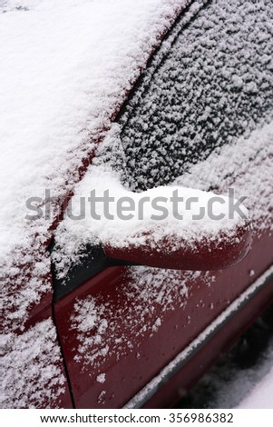 Car wing mirror all covered up with snow, close up image - stock photo