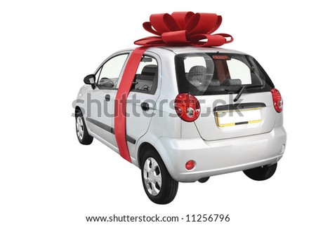 Car with bow isolated on a white background - stock photo