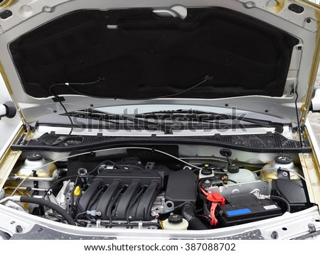Car with open hood.Battery. Details of new car engine.