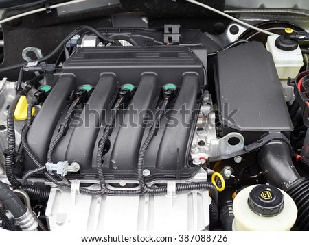 Car with open hood.Details of new car engine.