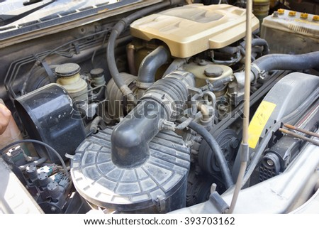 car with open hood show parts in side. - stock photo