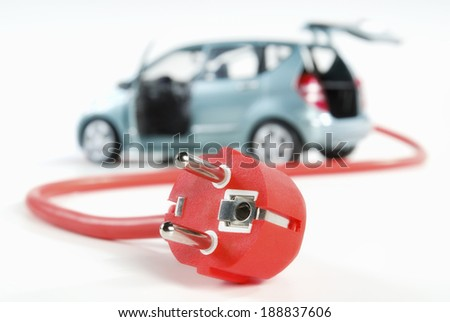 Car with red power cord and plug. - stock photo