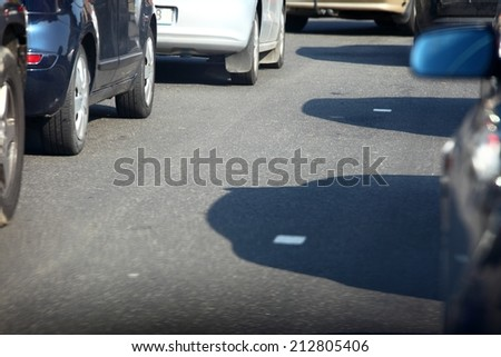car within traffic jam in rush hour highway in city cars everywhere around - stock photo