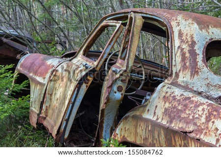Car wreck with open doors - stock photo