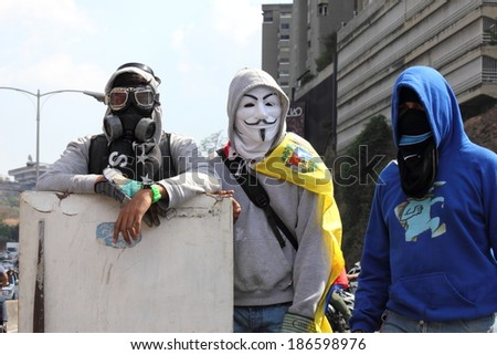 CARACAS, VENEZUELA - APRIL 10, 2014: Venezuelans protest in the street against the government for human rights violations and killings of civilians in peaceful demonstrations - stock photo