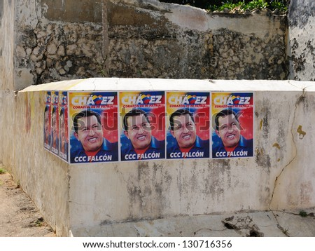 CARACAS, VENEZUELA - SEPTEMBER 29: Election poster on the wall  the president of Venezuela Hugo Chavez trying reelection to get in presidential elections in 2012 on  September 29, 2012 in Caracas - stock photo