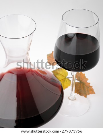 carafe with glass of red wine - stock photo