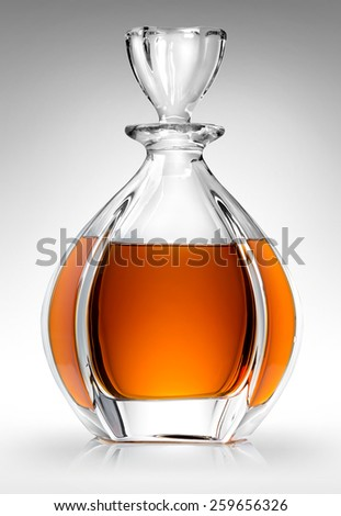 Carafe with whiskey on a gray background - stock photo