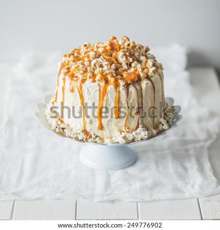 Caramel cake with pop corn - stock photo