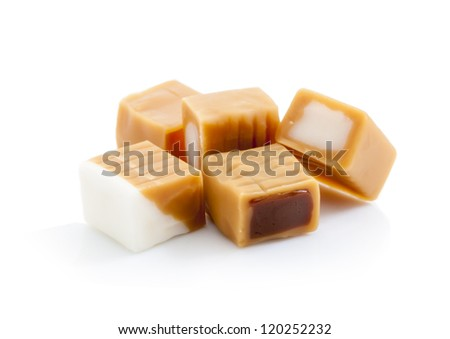 caramel candy with chocolate and cream filling isolated on white background - stock photo