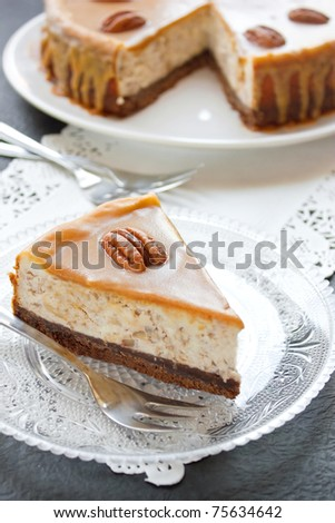 Caramel cheesecake with pecan nuts - stock photo