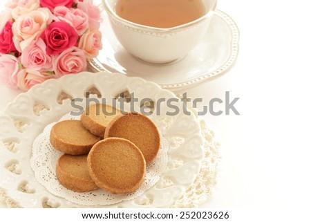 Caramel cookie and English tea - stock photo