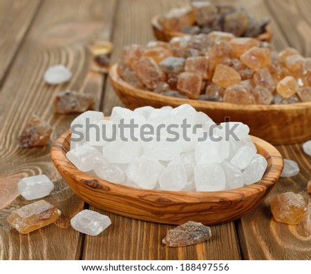 caramelized sugar in a bowl on a brown background