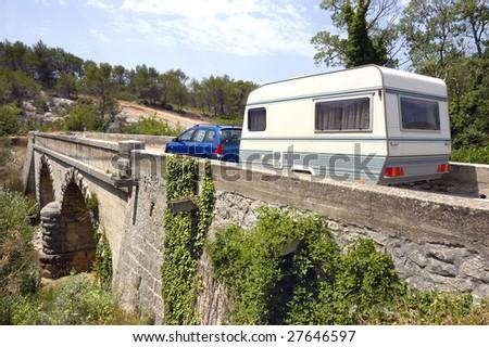 Caravan at a bridge in France - stock photo