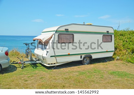 caravan bike sea holidays - stock photo