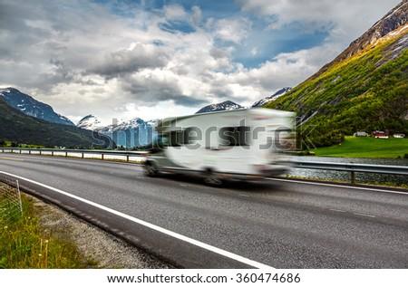 Caravan car travels on the highway. Caravan Car in motion blur. - stock photo